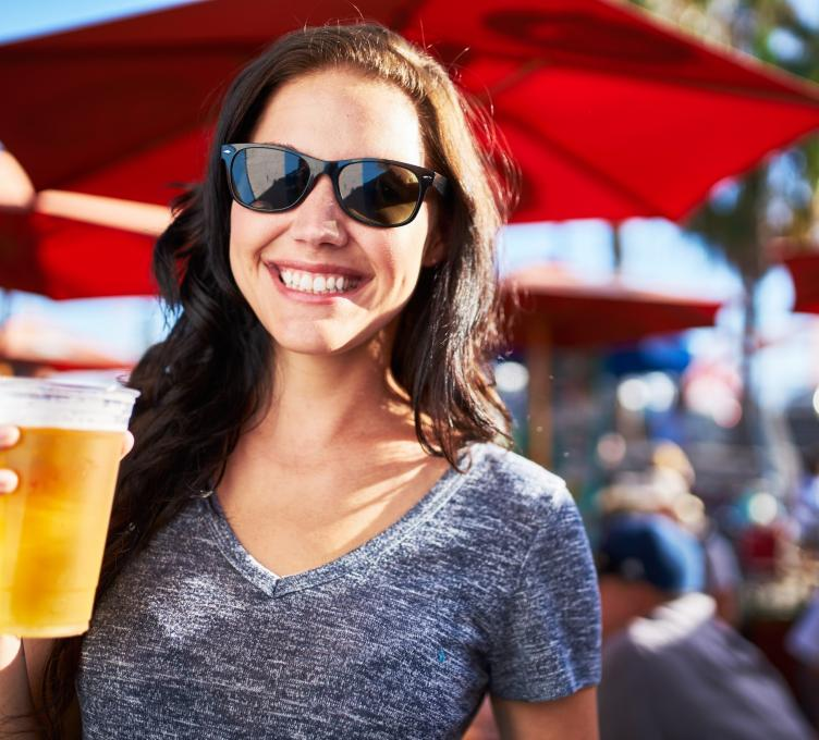 smiley girl holding a beer